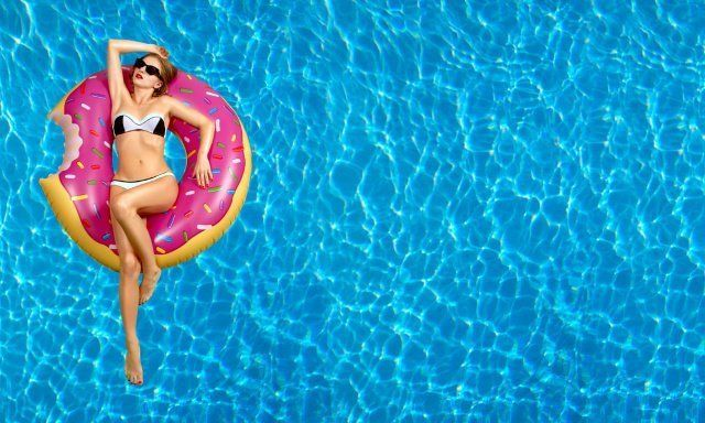 Woman on a donut floater